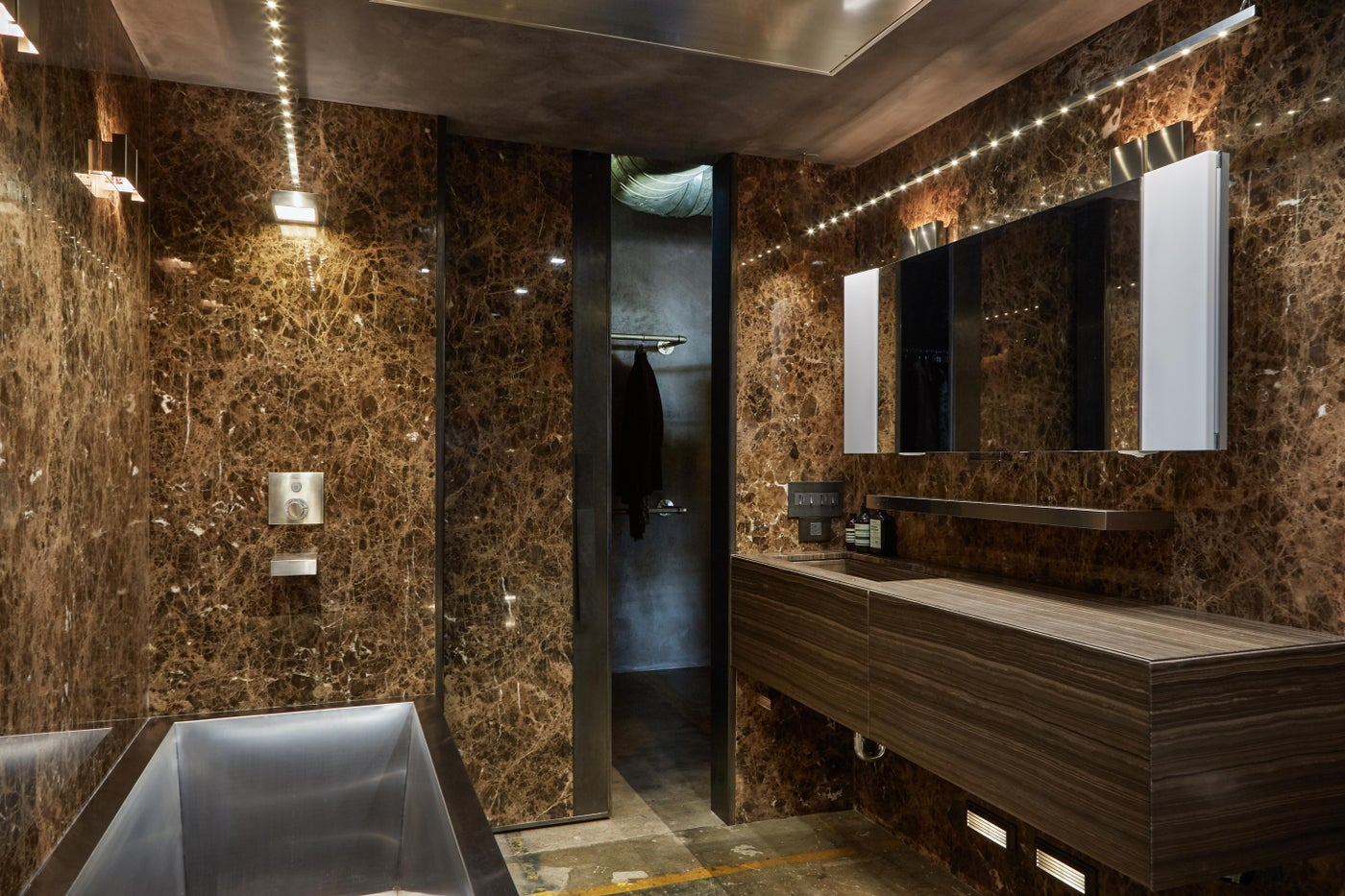 Marble walls, stainless soaking tub and floating vanity
