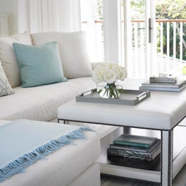 Blue accents create a casual yet elegant ambiance against a white backdrop.