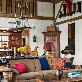 This Family Room features a colorful collection of antique folk art.