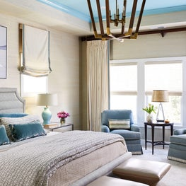 Bedroom blue painted ceiling wood chandelier grasscloth ottoman bedding