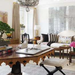 """Living room with etched glass panels, a Gothic revival table, and """"Dry Waterfall"""" by Georgia O'Keefe"""