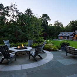 Fire pit overlooks the garden pathways and the estate car gallery