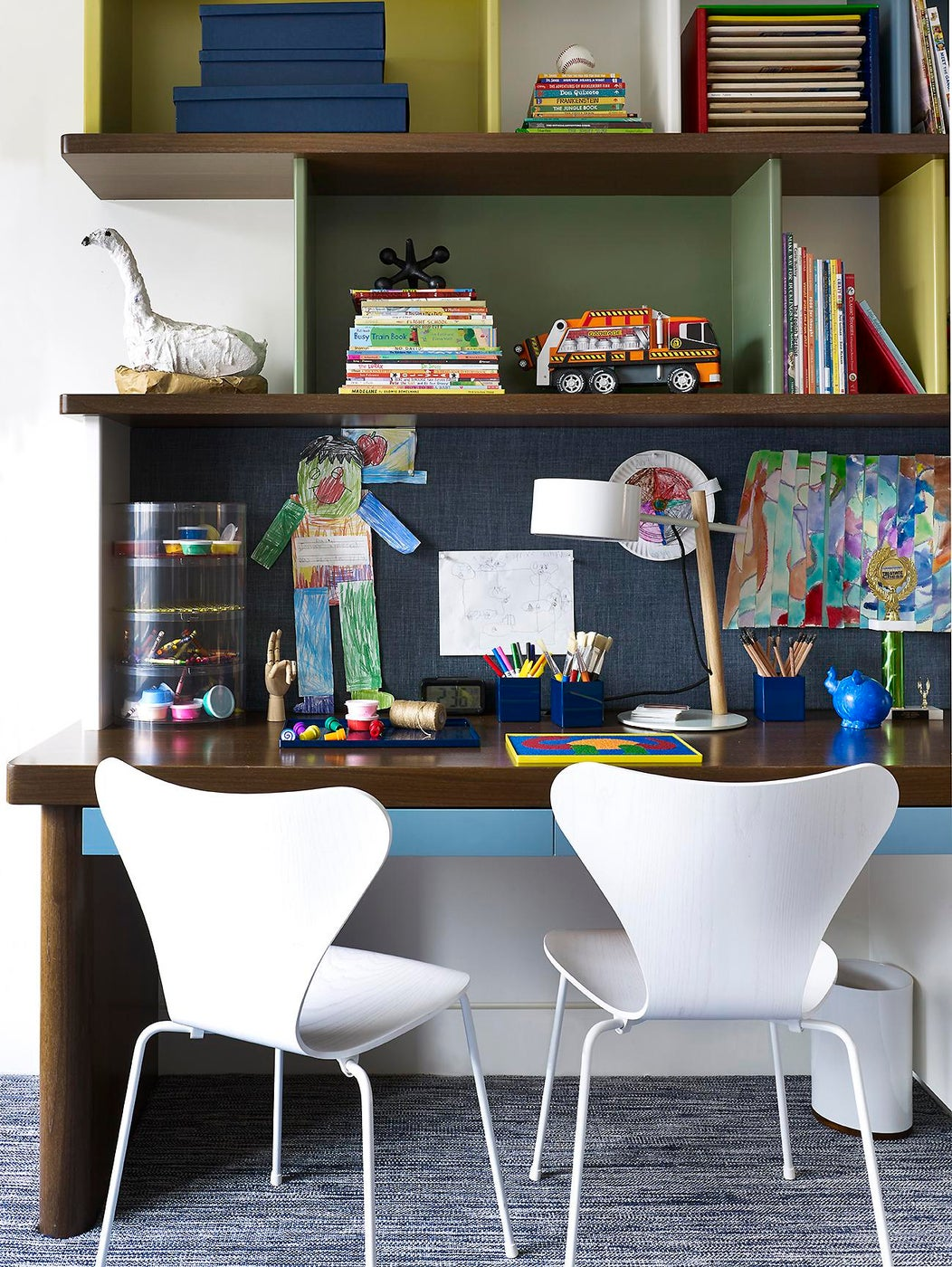 Custom kid's room desk with colorful lacquer built-ins and mid-century details.
