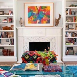 Living room with bookshelves and fireplace