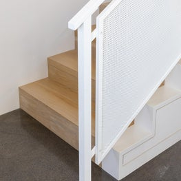 Maui, Hawaii perforated steel stair railing with white oak stairs