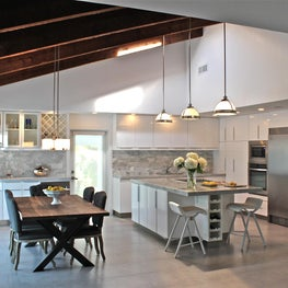 Open plan kitchen and breakfast room with vaulted wood ceiling