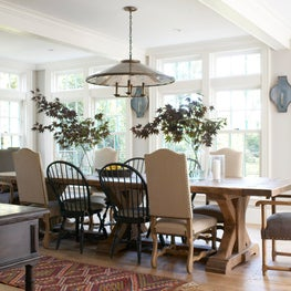 Bright & Open Dining Room featuring Floor to Ceiling Windows and Beam Ceiling