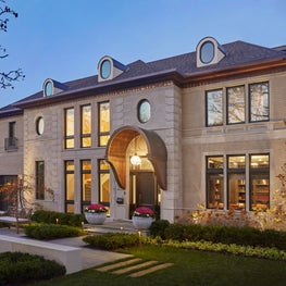 Art Deco Brick Home with Cut Limestone Quoins and Copper Entry