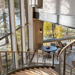 Curving staircase has dramatic views and effect.