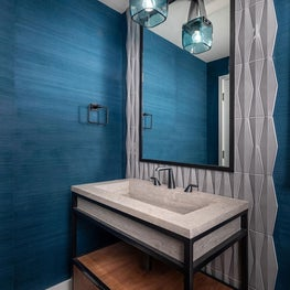 Open Plan Fusion - Cerulean blue glass pendant and textured wall covering, elongated hexagon tile and limestone sink