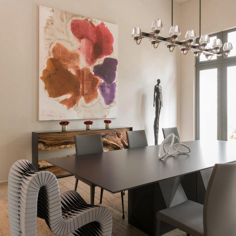 Contemporary dining space with modern furniture + abstract art; Houston, Texas