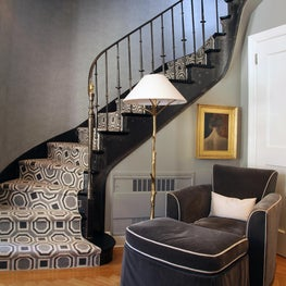 Upper East Side Stair Hall with iron railing, patterned stair runner