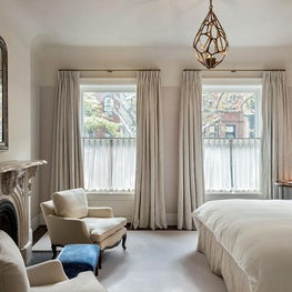 Dreamy master bedroom with upholstered walls and neutral tones