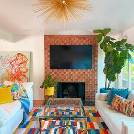 Mid century modern living room with wood tile fireplace