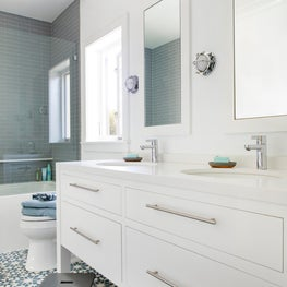 Whimsical kids' Jack and Jill bathroom with double sinks
