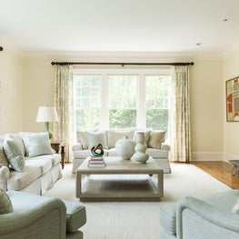 Transitional Family Room with Traditional Furnishings, Lamps from Circa, Modern Art by Stanley Bate and Linen Wrapped Coffee Table