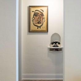 Bedroom hallway features S. Mouille pendant and vintage phone in original niche.