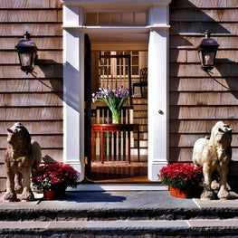 Shingle style house with classical door surround, transom &  bluestone steps.