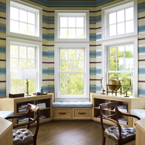 Octagonal double home office with horizontal stripe wallpaper and built-in benches