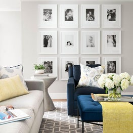 Family photo gallery is the focal point of this lush living room.
