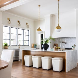 New Traditional Residence modern kitchen featuring a quarter sawn whiteoak island, venetian plaster venthood and marble waterfall counters.
