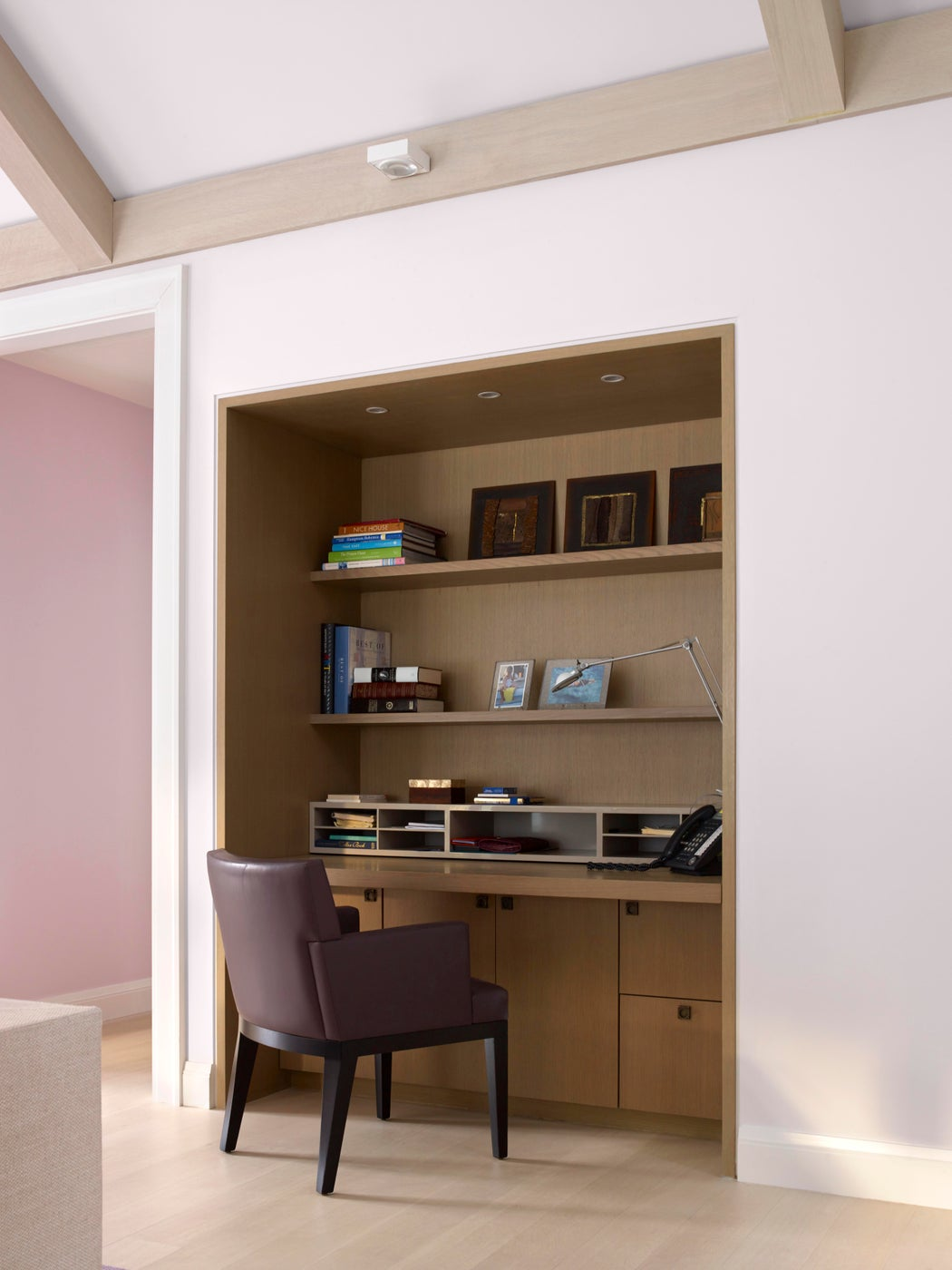 Home office with built-in desk, cabinetry and storage