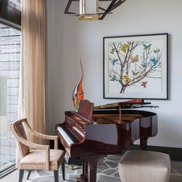 Music room featuring artwork by local artist George Dombek