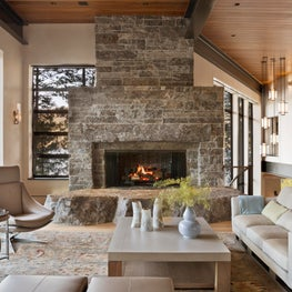 Locally sourced stone, enormous hearth juxtaposes rough & contemporary.
