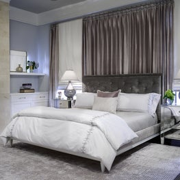 Chic master bedroom with warm neutrals + contemporary art; Houston Texas