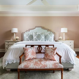 The backdrop of this master suite is a beautiful pale coral.