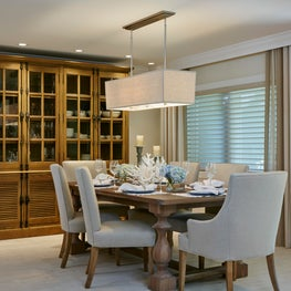 Open plan with neutral gray tones bring a Zen like quality to this dining room.