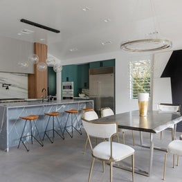 Dining Room and Kitchen Shot featuring Custom Stone, Oversized Contemporary Art, and Live-Edge Dining Table