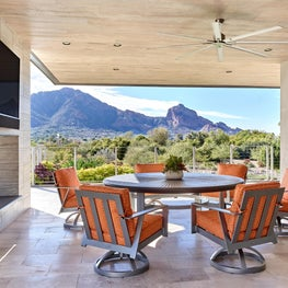 A massive 2-sided fireplace and Camelback mountain become art for outdoor living