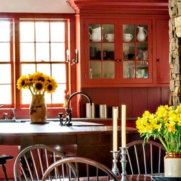 Detail of a bold red farmhouse kitchen.