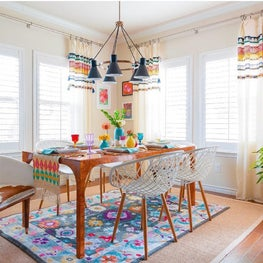 Eat-in kitchen dining with layered rugs