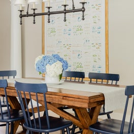 Kitchen Dining Area with rustic x-base table and faux-framed kid's artwork