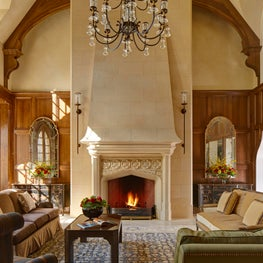 Edwardian Carved Limestone Fireplace in Formal Living Room - Minnesota