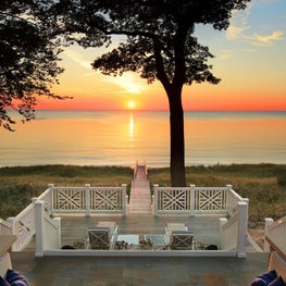 Pennsylvania bluestone paves the fire pit on the terrace down to a sunset lounge