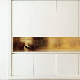 Gold Leaf Backed Millwork Cabinetry