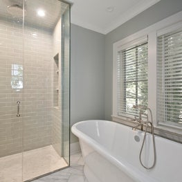 North End Boise master bathroom with stand alone tub and glass shower