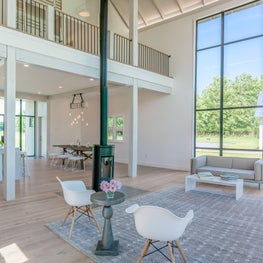 Modern barn house, great room with expansive Hope's windows (steel)