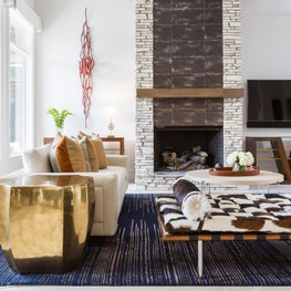 Living room featuring a custom sofa and cowhide Mies van der Rohe-style daybed