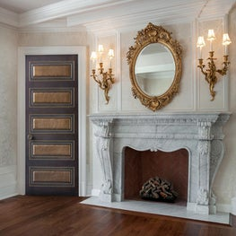 Alexandria door featuring pewter leather panels and custom carving