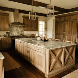 Farmhouse kitchen, large island, pendants, wood stained cabinets, wood floor