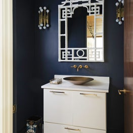 Vintage mirror adds a whimsical ambiance to this powder room