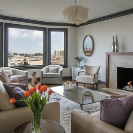Custom fireplace and dark trim to frame the view