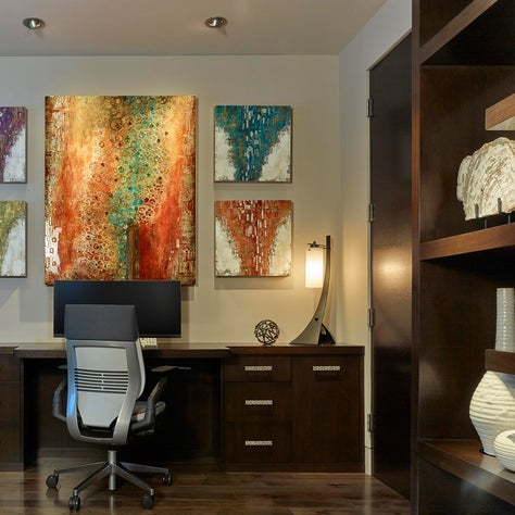 Modern Office with bold art, custom cabinetry and cantilever etagere