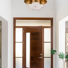 Minimalist entryway with floral scalloped gold chandelier lighting