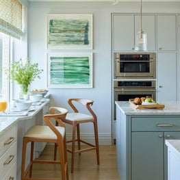 Soothing and serene green and blue kitchen with window breakfast bar, stools