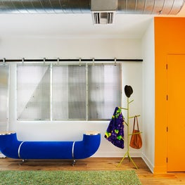 Santa Monica Loft, Entry Featuring Custom Window Screens and Pipe Bench by Dune